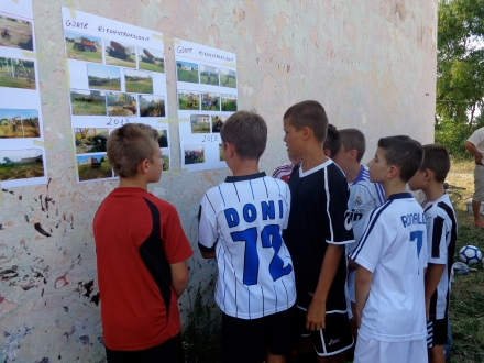 Some of the boys checking out pictures of the grant progress.