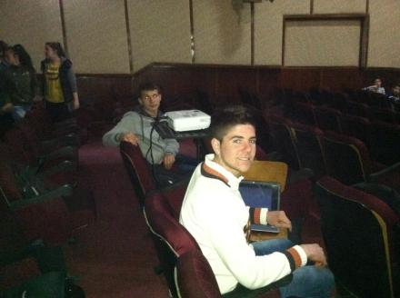 The boys setting up all the technology before the showing.